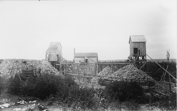 Photograph of shafts and track systems surrounded by piles of discarded rock.