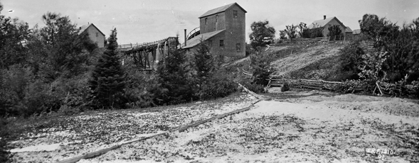 Photograph of a stamp mill and tailings.