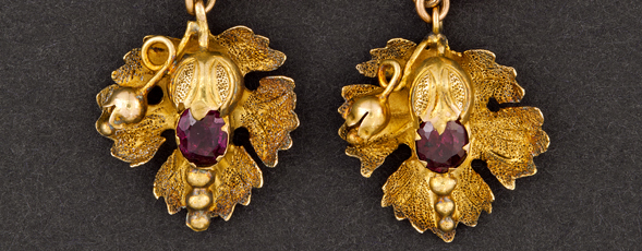 14K gold flower earrings with garnet centre made by Julius Cornelius.