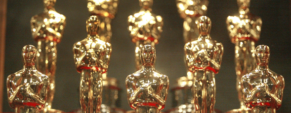 Photograph of rows of Oscars.