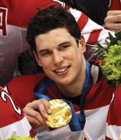 A photograph of Sidney Crosby holding his Vancouver 2010 Olympic medal.