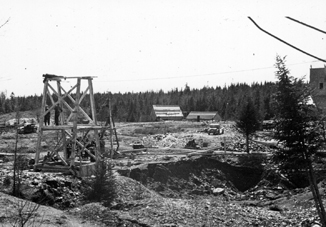 Photograph of rescue workers around newly constructed headframe