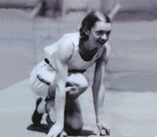 A photograph of Olympic runner Aileen Meagher in a crouched start position.