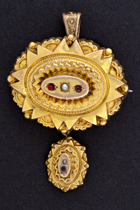 Gold brooch embedded with garnets made by Julius Cornelius.