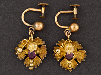 14K gold flower earring with garnet centre, made by Julius Cornelius.