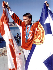 World Championship winning canoeist Steve Giles holding the Canadian and Nova Scotian flags.
