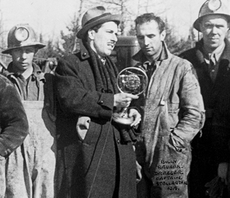 CRBC radio reporter J. Frank Willis interviewing rescue workers, Moose River, 1936.