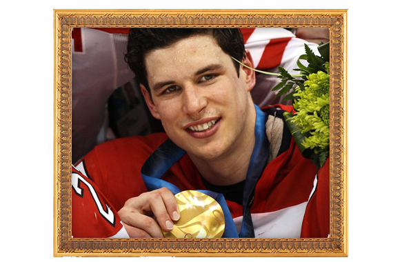 Sidney Crosby holding his 2010 Olympic gold medal for men's ice hockey.