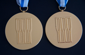 Two gold medals from the 2005 and 2010 World Rowing Championships.