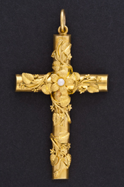 Gold pendent in the shape of a cross with mayflowers twining around it, with a pearl in the centre-most flower.